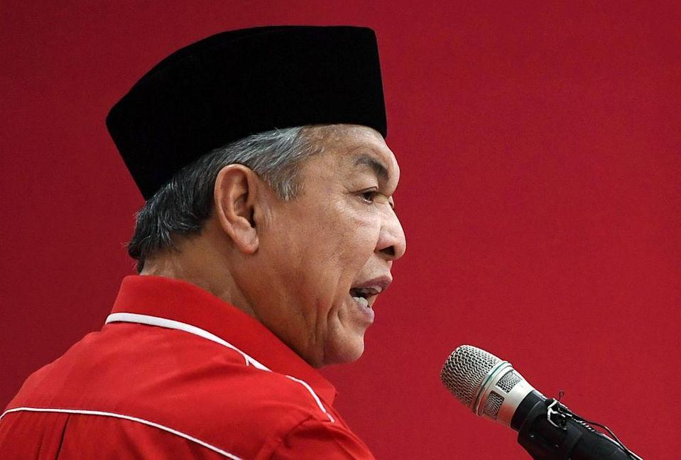 Umno President Datuk Seri Ahmad Zahid Hamidi said it is keeping with the status quo without joining forces with PKR and DAP. — Bernama pic