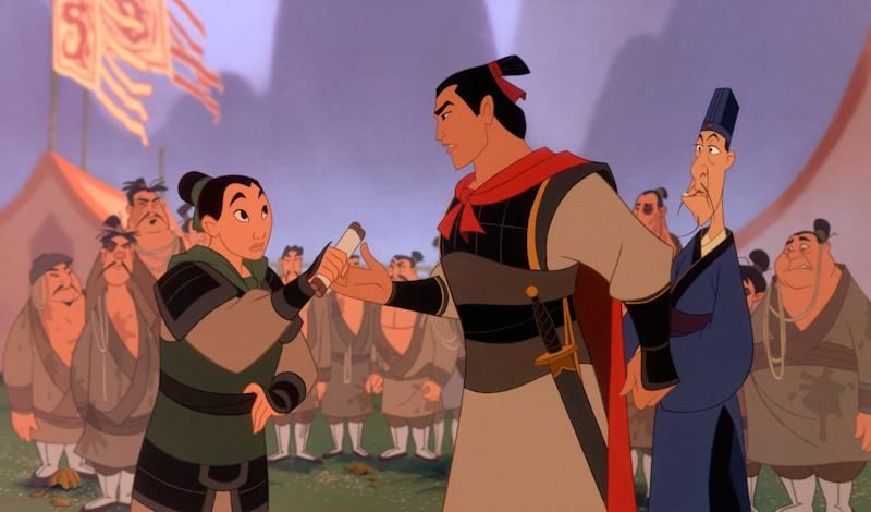 MULAN, Mulan (left, voice: Ming-Na), Shang, (center, voice: B.D. Wong), 1998. Buena Vista Pictures/Courtesy Everett Collection.