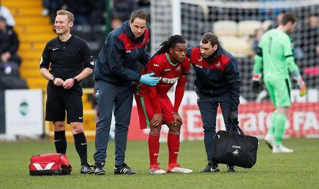 Soccer Football - FA Cup Fourth Round - Notts County vs Swansea City - Meadow Lane, Nottingham, Britain - January 27, 2018 Swansea City's Renato Sanches receives medical treatment before being substituted off REUTERS/David Klein