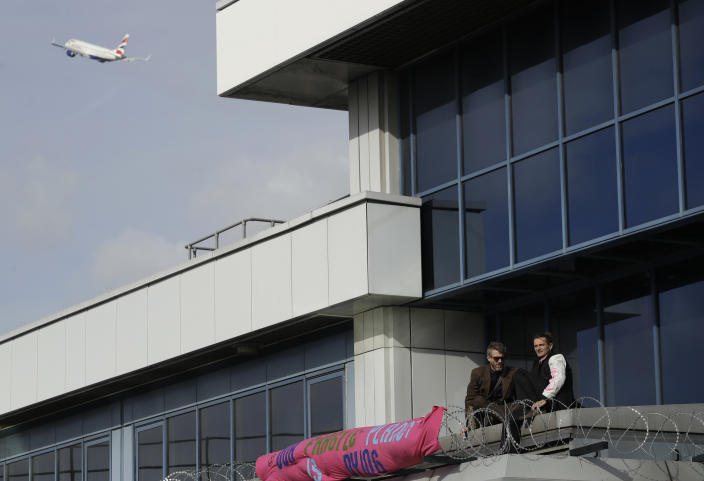 Demonstrators climbed onto the roof at London City Airport. (AP)