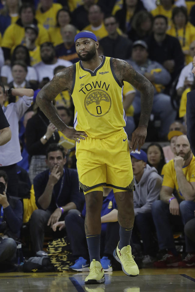 FILE - In this April 15, 2019, file photo, then-Golden State Warriors center DeMarcus Cousins reacts after injuring his leg during the first half of Game 2 of a first-round NBA basketball playoff series against the Los Angeles Clippers in Oakland, Calif. A person with knowledge of the situation says Los Angeles Lakers center DeMarcus Cousins is undergoing tests to confirm a preliminary diagnosis of a ligament tear in his knee. Cousins was injured in a workout in Las Vegas this week, according to the person who spoke on condition of anonymity to The Associated Press on Thursday, Aug. 15, 2019, because no official diagnosis has been released publicly. (AP Photo/Jeff Chiu, File)