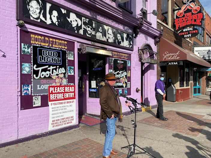 Downtown honky-tonk owner Steve Smith speaks to reporters outside Tootsies Orchid Lounge on Tuesday afternoon.
