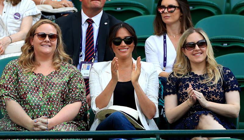 Duchess of Sussex watches Serena Williams on court one on day four of the Wimbledon Championships at the All England Lawn Tennis and Croquet Club, Wimbledon.