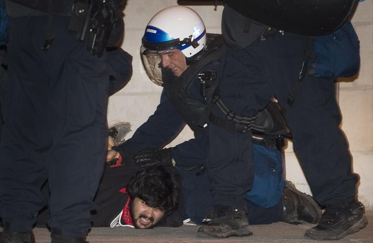 A protester opposing Quebec student tuition fee hikes is arrested during a demonstration in Montreal, Sunday, May 20, 2012. (AP Photo/The Canadian Press, Graham Hughes)