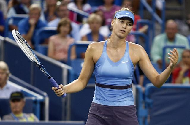 Maria Sharapova, from Russia, reacts in a semifinal against Ana Ivanovic, from Serbia, at the Western & Southern Open tennis tournament, Saturday, Aug. 16, 2014, in Mason, Ohio. Ivanovic won 6-2, 5-7, 7-5. (AP Photo/David Kohl)