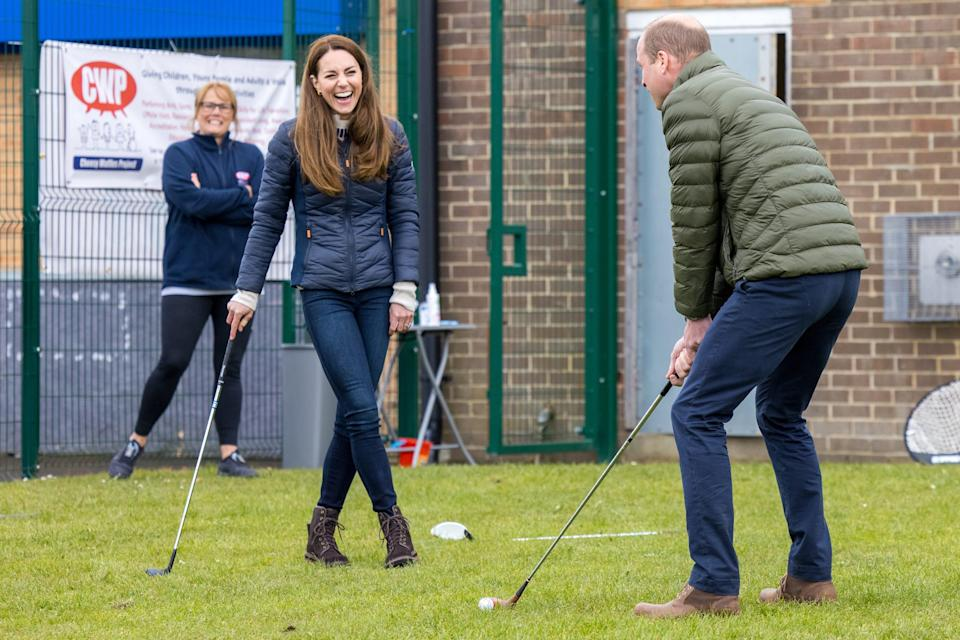 Prince William and Duchess Kate try a few swings as they meet young people supported by the charity Cheesy Waffles Project in County Durham on April 27, 2021. The charity received donations through the couple's Royal Wedding Charitable Gift Fund.