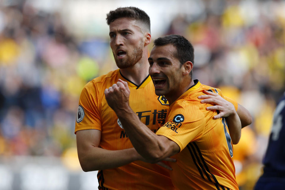 WOLVERHAMPTON, ENGLAND - SEPTEMBER 28: Goalscorer Matt Doherty of Wolverhampton Wanderers celebrates with Jonny Castro Otto  during the Premier League match between Wolverhampton Wanderers and Watford FC at Molineux on September 28, 2019 in Wolverhampton, United Kingdom. (Photo by Malcolm Couzens/Getty Images)