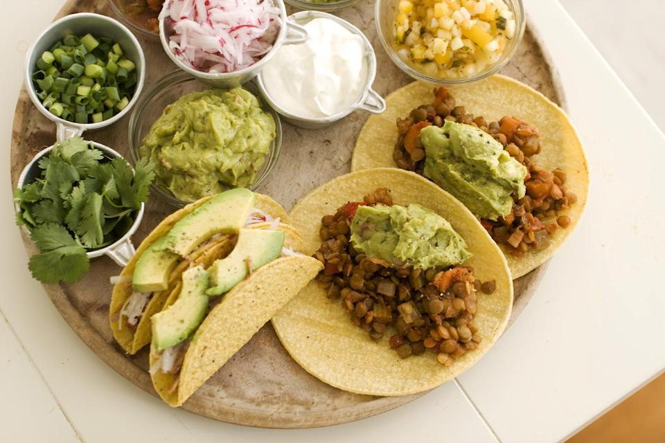 In this image taken on May 13, 2013, pulled pork tacos, left, and lentil tacos are served on a plate as seen in Concord, NH. (AP Photo/Matthew Mead)