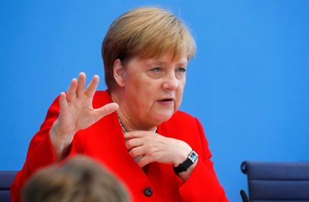 FILE PHOTO: German Chancellor Angela Merkel holds the annual summer news conference in Berlin