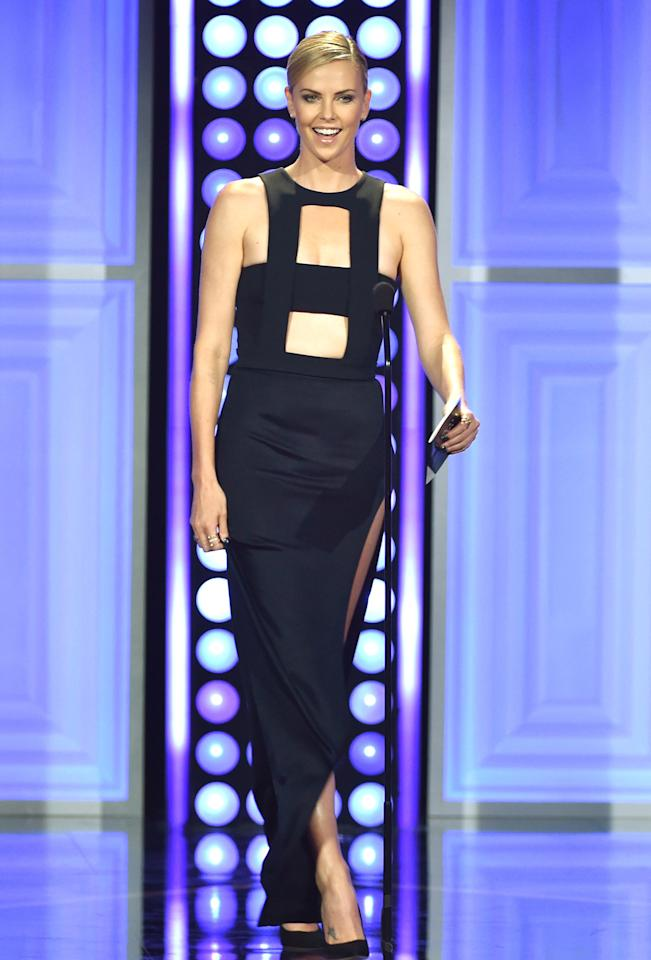 "Charlize Theron in a Cushnie Et Ochs dress with lots of cutouts — which can easily go really wrong — were elegant on Charlize Theron. Presenting an award (she skipped the step-and-repeat), the ""Mad Max"" actress walked onto the stage and owned it like it was a runway."