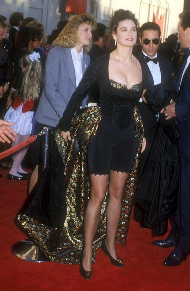 Demi Moore, 1989. Moms everywhere should be proud: Demi made her own dress! Critics everywhere were not as fond of the black DIY project, which involved lacy bicycle shorts, a metallic-trim bustier, and a metallic cape -- because it was the '80s, after all. All that was missing was a single lace glove and a neon hairband.