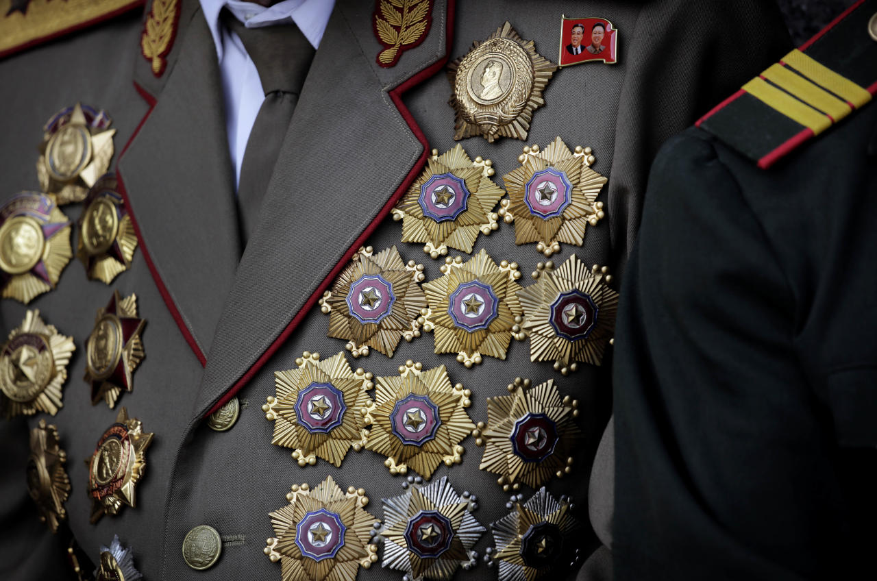 A North Korean war veteran is decorated with medals as he attends a parade to celebrate the anniversary of the Korean War armistice agreement, Sunday, July 27, 2014 in Pyongyang, North Korea. North Koreans gathered at Kim Il Sung Square as part of celebrations for the 61st anniversary of the armistice that ended the Korean War. (AP Photo/Wong Maye-E)