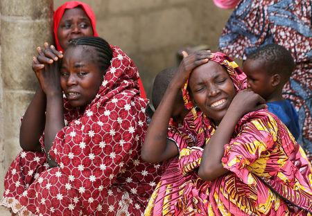 Relatives of missing school girls react in Dapchi in the northeastern state of Yobe, after an attack on the village by Boko Haram, Nigeria February 23, 2018. REUTERS/Afolabi Sotunde