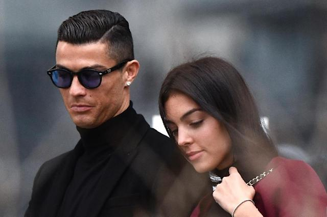 Ronaldo and Rodriguez left court after the star was sentenced. (AFP Photo/OSCAR DEL POZO)