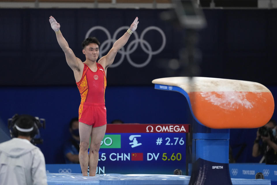 Sun Wei, of China, performs on the vault during the artistic gymnastics men's all-around final at the 2020 Summer Olympics, Wednesday, July 28, 2021, in Tokyo. (AP Photo/Ashley Landis)