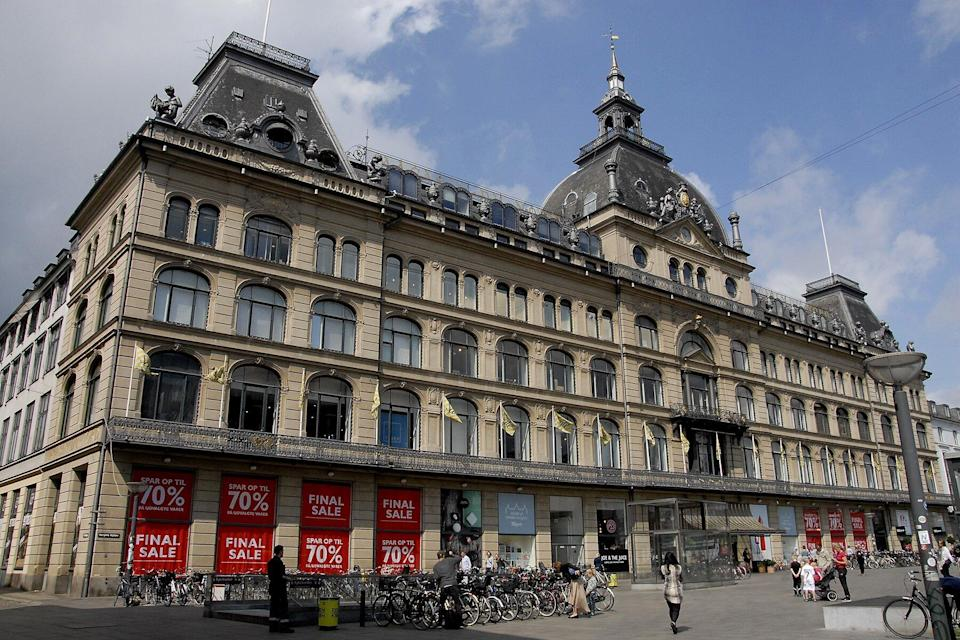 Shoppers walk by windows at Magasin du nord department store