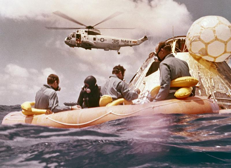 Sitting in the life raft, during the Apollo 12 Pacific recovery, are the three mission astronauts; Alan L. Bean, pilot of the Lunar Module (LM), Intrepid; Richard Gordon, pilot of the Command Module (CM), Yankee Clipper; and Spacecraft Commander Charles Conrad. The second manned lunar landing mission, Apollo 12 launched from launch pad 39-A at Kennedy Space Center in Florida on November 14, 1969 via a Saturn V launch vehicle. The Saturn V vehicle was developed by the Marshall Space Flight Center (MSFC) under the direction of Dr. Wernher von Braun. The LM, Intrepid, landed astronauts Conrad and Bean on the lunar surface in what?s known as the Ocean of Storms, while astronaut Richard Gordon piloted the CM, Yankee Clipper, in a parking orbit around the Moon. Lunar soil activities included the deployment of the Apollo Lunar Surface Experiments Package (ALSEP), finding the unmanned Surveyor 3 that landed on the Moon on April 19, 1967, and collecting 75 pounds (34 kilograms) of rock samples. Apollo 12 safely returned to Earth on November 24, 1969.
