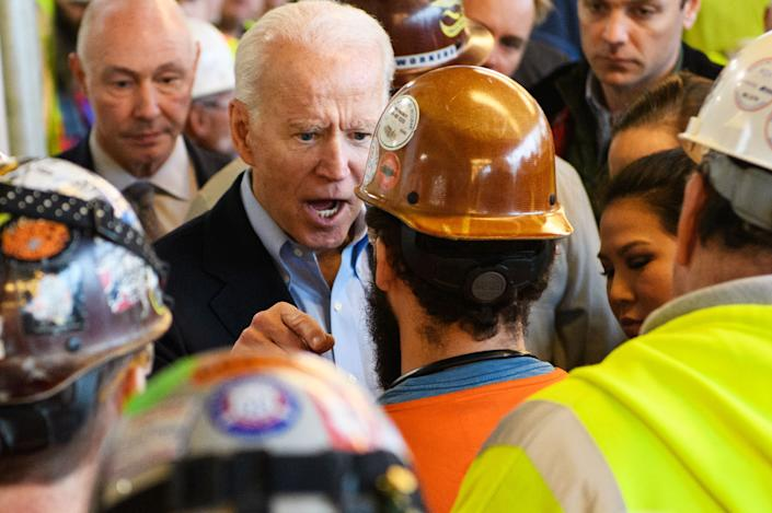 TOPSHOT - Democratic presidential candidate Joe Biden meets workers and discusses gun rights as he tours the Fiat Chrysler plant in Detroit, Michigan on March 10, 2020. (Photo by MANDEL NGAN / AFP) (Photo by MANDEL NGAN/AFP via Getty Images)