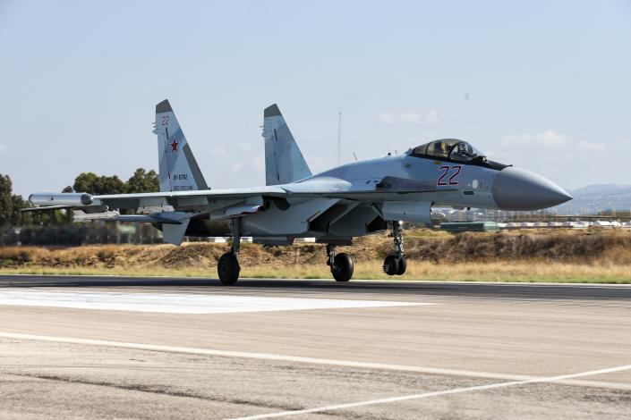 CAPTION CORRECTS PLANE TYPE - A Russian Su-35 fighter jet takes off at Hemeimeem air base in Syria, Thursday, Sept. 26, 2019. (AP Photo/Alexander Zemlianichenko)