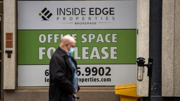 A sign on an office building's window in Ottawa indicates it has space available for lease in late March 2021. The pandemic has affected businesses over the past year.