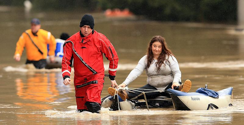 Anna Gaffney is pulled to shore by Jason Clopton of the Russian River Fire District swift water rescue team in Guerneville, Calif., Feb. 27, 2019. (Photo: Kent Porter/The Press Democrat via AP)