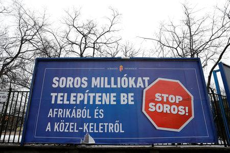 A government billboard is seen in Budapest, Hungary, February 14, 2018. A billboard reads: 'Soros wants to transplant millions from Africa and the Middle East'. REUTERS/Bernadett Szabo