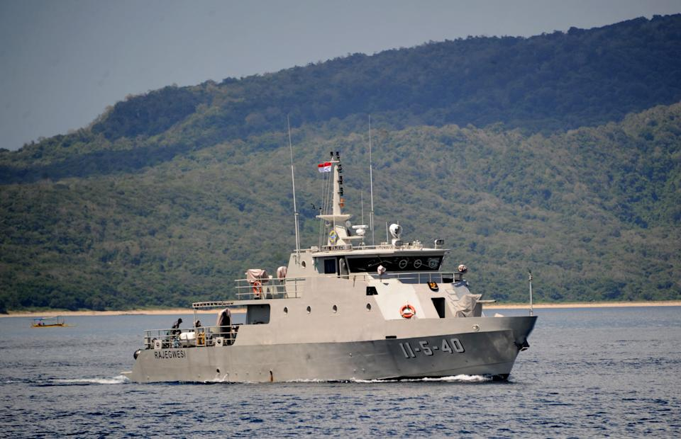 The Indonesian Navy patrol boat KRI Rajegwesi arrives at the naval base in Banyuwangi, East Java province on April 24, 2021, as the military continues search operations off the coast of Bali for the Navy's KRI Nanggala (402) submarine that went missing April 21 during a training exercise. (Photo by SONNY TUMBELAKA / AFP) (Photo by SONNY TUMBELAKA/AFP via Getty Images)
