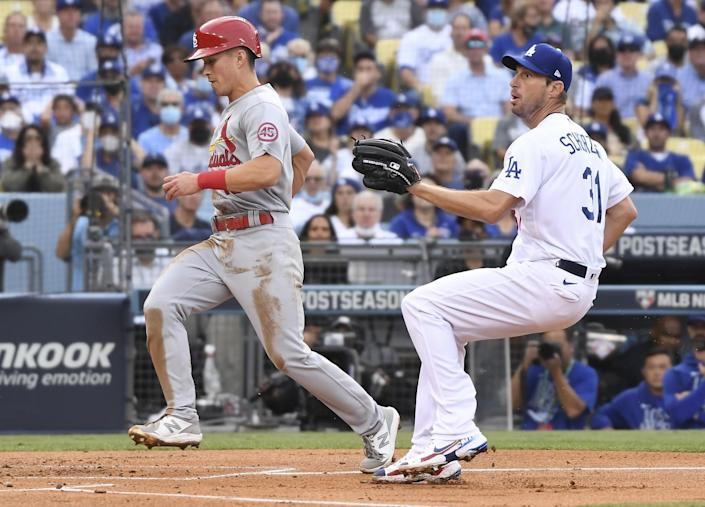 Louis Cardinals' Tommy Edman, left, scores ahead of the catch by Los Angeles Dodgers starting pitcher Max Scherzer