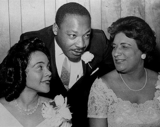 <p>Dr. Martin Luther King, Jr., president of the Southern Christian Leadership Conference, chats with his wife, Coretta, left, and civil rights champion Constance Baker Motley before the start of an S.C.L.C. banquet Aug. 9, 1965, in Birmingham, Ala. (AP Photo) </p>