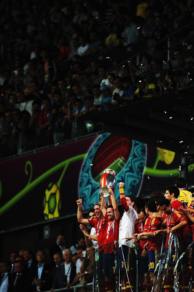 KIEV, UKRAINE - JULY 01: Juan Mata (C) of Spain lifts the trophy as he celebrates following victory in the UEFA EURO 2012 final match between Spain and Italy at the Olympic Stadium on July 1, 2012 in Kiev, Ukraine. (Photo by Jasper Juinen/Getty Images)