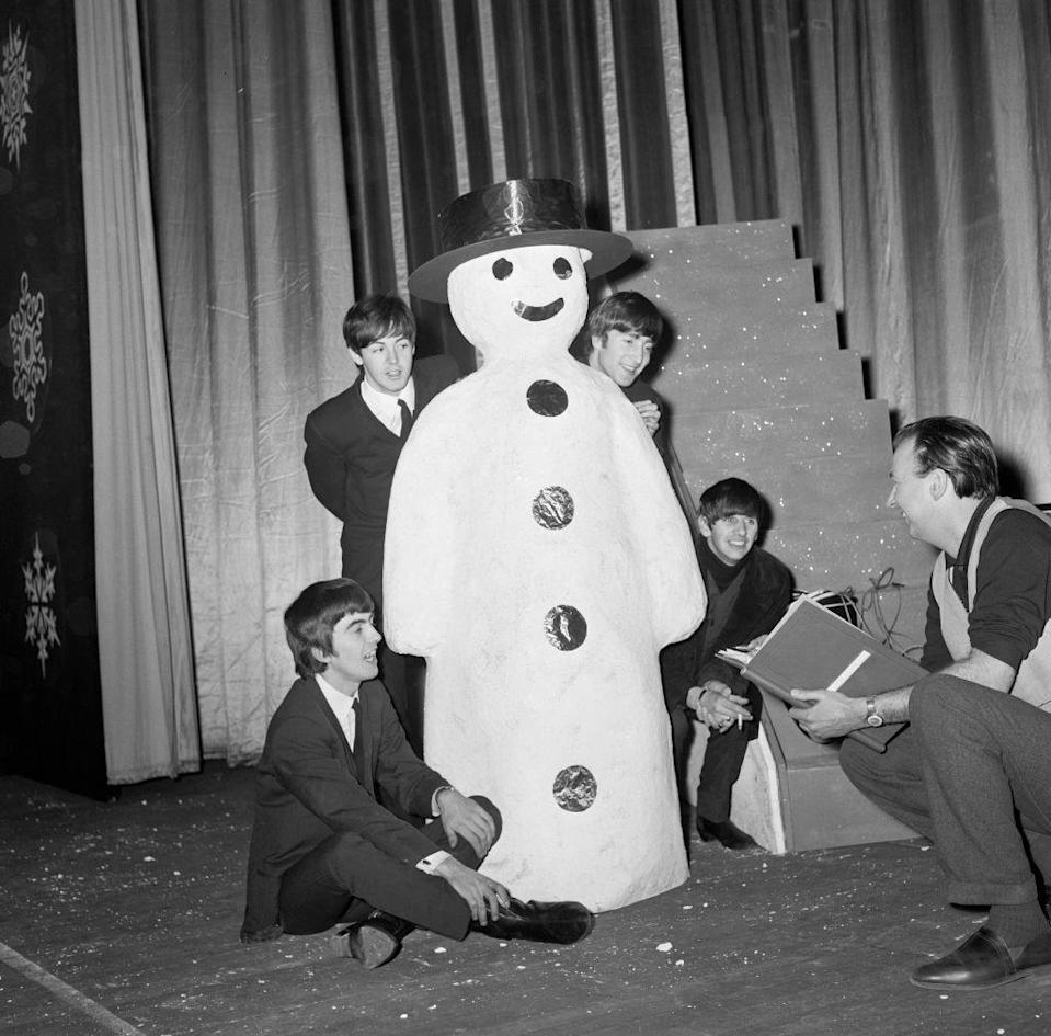 <p>The English singers pose next to a snowman as they prep for a show at the Astoria Cinema in London on December 19, 1963.</p>