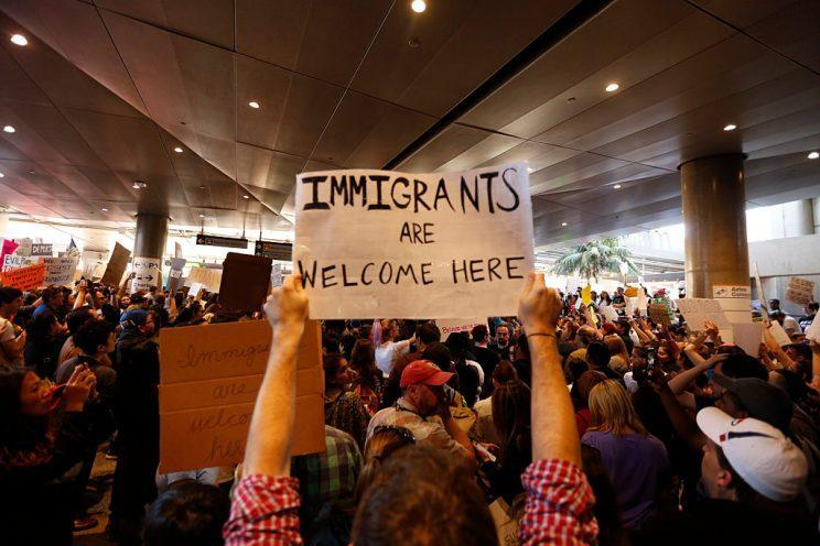 Hundreds of people protest President Donald Trump's travel ban at the Tom Bradley International Terminal at LAX on January 29, 2017. (Getty)