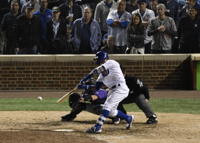 Chicago Cubs' Javier Baez (9) hits a one-run double against the Colorado Rockies during the eighth inning of the National League wild-card playoff baseball game, Tuesday, OCT. 2, 2018, in Chicago. (AP Photo/David Banks)