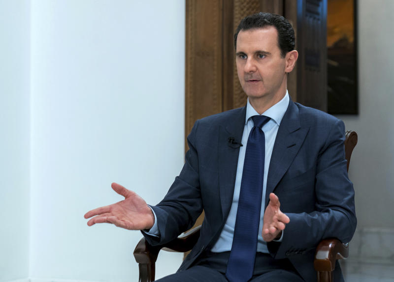 "In this photo released on Sunday, June 10, 2018 by the Syrian official news agency SANA, Syrian President Bashar Assad speaks during an interview with the Daily Mail, in Damascus, Syria. In the interview Assad said the West is fueling the devastating war in his country, now in its eighth year, with the aim of toppling him. Assad said that Western nations have lied about chemical attacks in Syria and supported terrorist groups there, while Russia has supported his government against the foreign ""invasion."" (SANA via AP)"