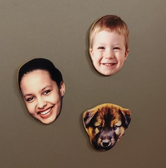 """<h3><a href=""""https://www.etsy.com/listing/720357028/family-faces-custom-refrigerator-magnets"""" rel=""""nofollow noopener"""" target=""""_blank"""" data-ylk=""""slk:Custom Photo Magnets"""" class=""""link rapid-noclick-resp"""">Custom Photo Magnets</a></h3><br>These hand-cut and crafted custom face-photo magnets make for uniquely thoughtful stocking stuffers. <br><br><strong>WoodcraftCentral</strong> Faces Custom Refrigerator Magnets, $, available at <a href=""""https://www.etsy.com/listing/720357028/family-faces-custom-refrigerator-magnets"""" rel=""""nofollow noopener"""" target=""""_blank"""" data-ylk=""""slk:Etsy"""" class=""""link rapid-noclick-resp"""">Etsy</a>"""