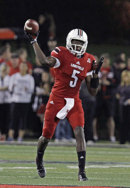 Louisville quarterback Teddy Bridgewater (5) throws a pass during the first half against Rutgers in an NCAA college football game in Louisville, Ky., Thursday, Oct. 10, 2013. (AP Photo/Garry Jones)