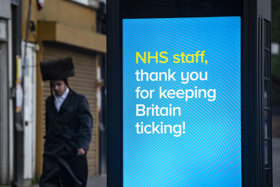 LONDON, ENGLAND - APRIL 08: A billboard thank NHS staff in Stamford Hill on the evening of the Jewish holiday of Passover on April 8, 2020 in London, England. The Jewish community is preparing to celebrate Passover amid COVID-19 home isolation and social distancing measures. (Photo by Hollie Adams/Getty Images)