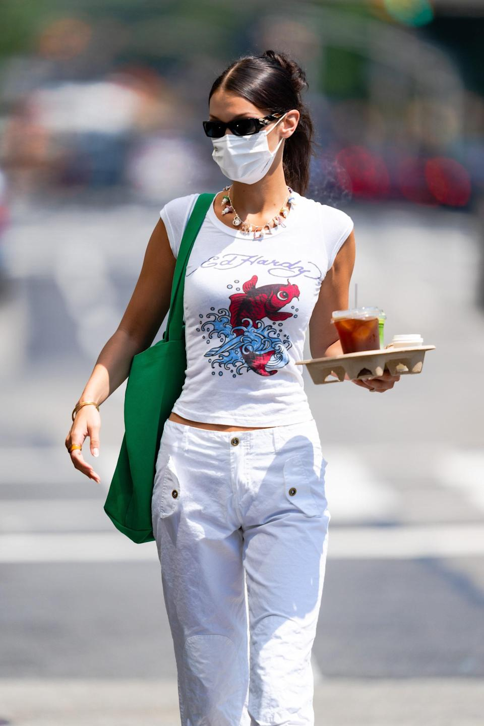 Bella Hadid, this month, in an Ed Hardy tee