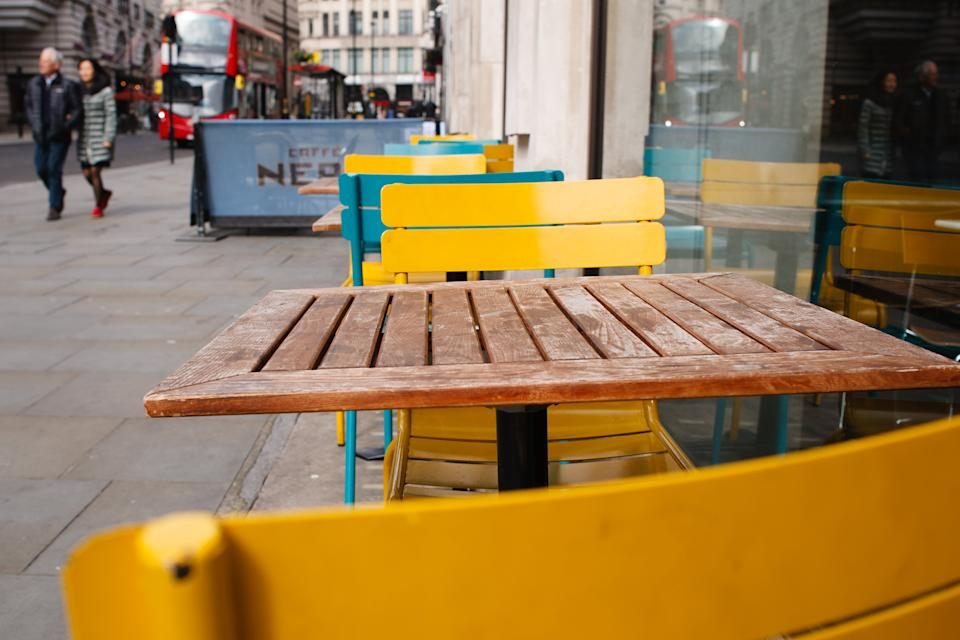 Tables and chairs stand vacant outside a branch of Italian food chain Pizza Express on Haymarket in London, England, on March 17, 2020. Hospitality industry figures are warning of dire consequences for the sector as a result of the coronavirus crisis. London's streets and squares were noticeably quieter today than just 24 hours ago, albeit not deserted. The emptying-out follows new guidance issued yesterday for people to avoid all non-essential social contact and avoid places such as restaurants and pubs to help stem the tide of covid-19 coronavirus cases. But the British government has so far not followed the path taken by some other countries to require everyone to remain in their homes. (Photo by David Cliff/NurPhoto via Getty Images)