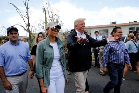 FILE PHOTO: U.S. President Donald Trump and first lady Melania Trump walk through a neighborhood damaged by Hurricane Maria in Guaynabo, Puerto Rico, U.S., October 3, 2017. REUTERS/Jonathan Ernst/File Photo