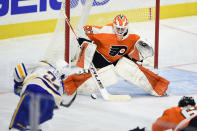 Philadelphia Flyers goaltender Brian Elliott watches the shot from Buffalo Sabres' Dylan Cozens during the second period of an NHL hockey game, Tuesday, Jan. 19, 2021, in Philadelphia. (AP Photo/Derik Hamilton)