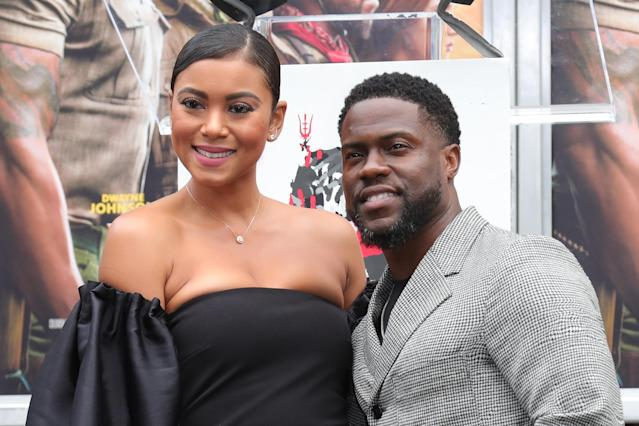 Kevin Hart (R) and wife Eniko Parrish pose as Hart is honored with a Hand And Footprint Ceremony at TCL Chinese Theatre on December 10, 2019 in Hollywood, California. (Photo by Leon Bennett/WireImage)