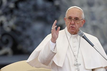 Pope Francis blesses the faithful during his Wednesday general audience in Saint Peter's square at the Vatican