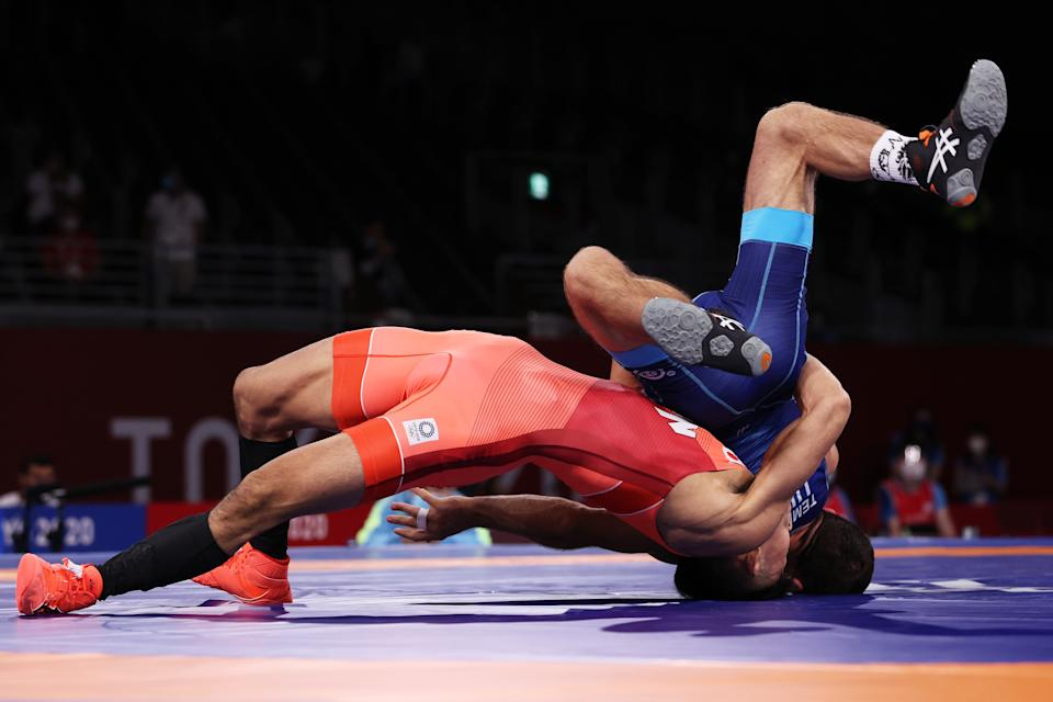 <p>CHIBA, JAPAN - AUGUST 01: Kenichiro Fumita of Team Japan competes against Lenur Temirov of Team Ukraine during the Men's Greco-Roman 60kg Semi Final on day nine of the Tokyo 2020 Olympic Games at Makuhari Messe Hall on August 01, 2021 in Chiba, Japan. (Photo by Tom Pennington/Getty Images)</p>