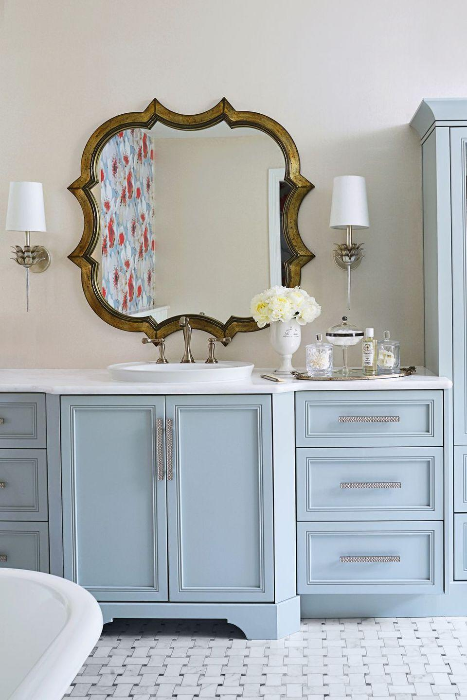 <p>Blue cabinetry and tiles in an interlocking pattern add flair to a traditional cream backdrop. <br></p>