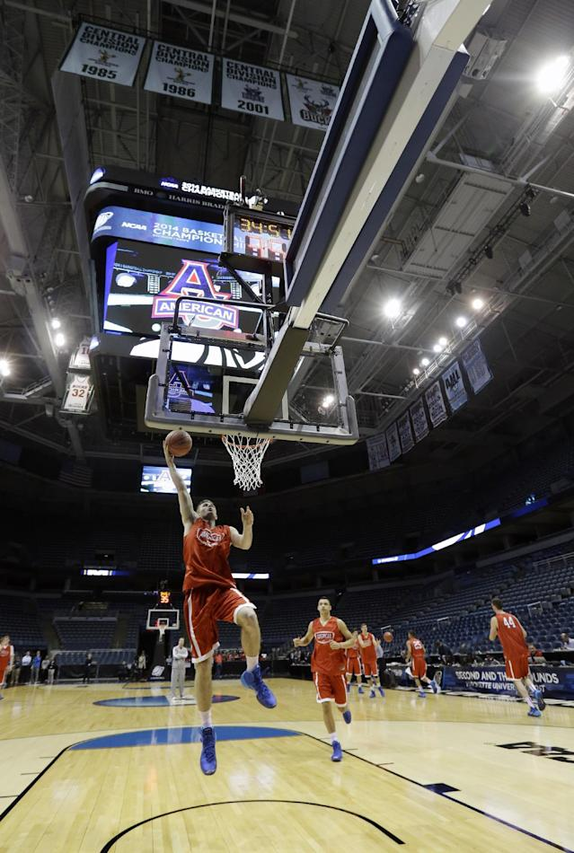 American University guard Kade Kager goes up for shot during a practice session for their NCAA college basketball tournament game Wednesday, March 19, 2014, in Milwaukee. American plays Wisconsin in round two on Thursday. (AP Photo/Morry Gash)