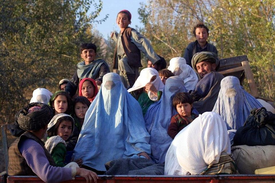 Kalaqata residents, in the Takhar province, fleeing the frontline as US fighter planes bomb Taliban positions in November 2001 (AFP/Getty)