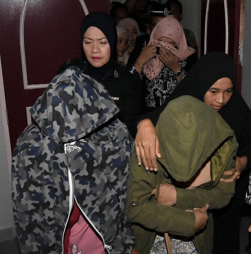 Yesterday, two women found guilty for attempting to have lesbian sex were caned six times in public at the Terengganu Syariah Court, as around 100 people watched the punishment. — Bernama pic