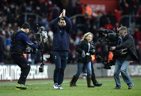 Tottenham Hotspur caretaker manager Tim Sherwood gestures to fans after winning their English Premier League soccer match against Southampton at St Mary's stadium in Southampton, southern England December 22, 2013. REUTERS/Dylan Martinez