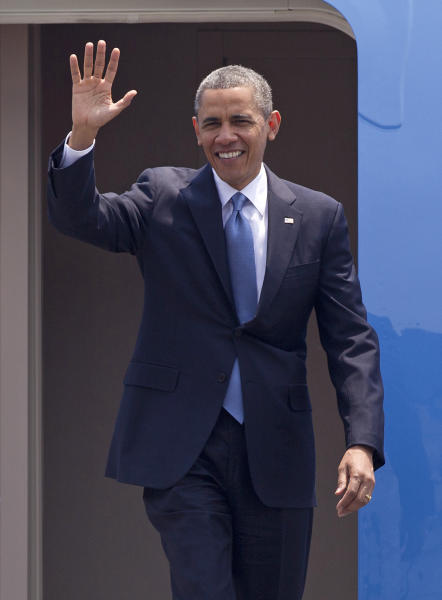 President Barack Obama waves as he arrives to Benito Juarez International airport in Mexico City, Thursday, May 2, 2013. Obama arrived to Mexico for a two-day visit. (AP Photo/Eduardo Verdugo)